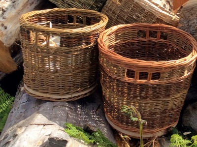 small log basket made with natural barked willow and a wooden base